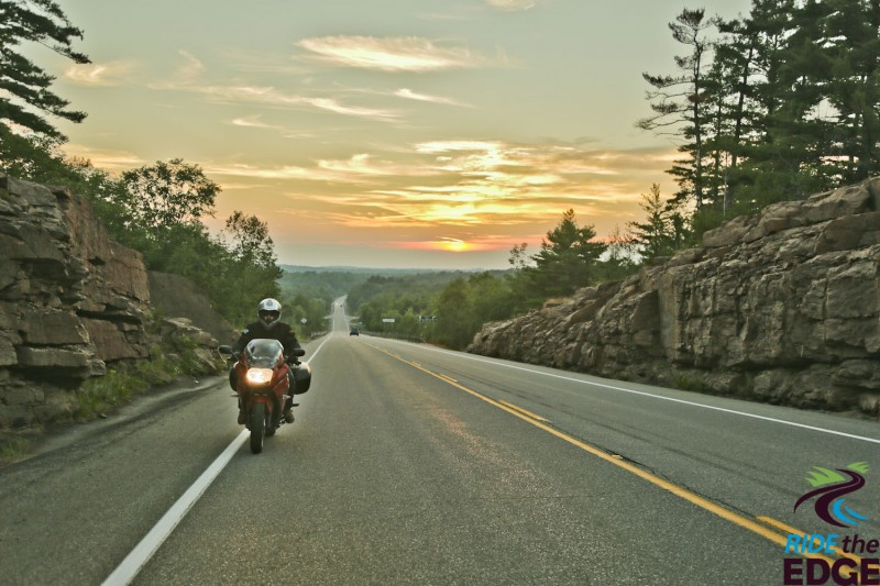 motorcycle riding at sunset in Explorers' Edge